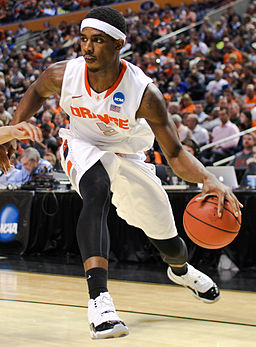 CJ Fair NBA basketball player dribbling up court