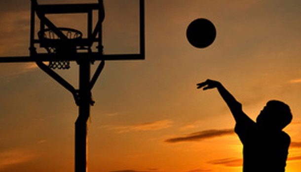 silhouette of person shooting a basketball