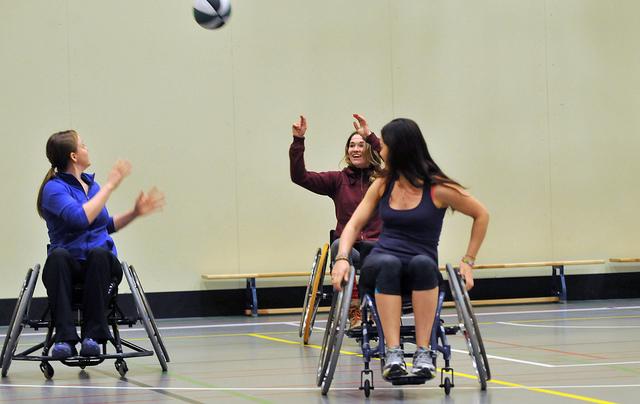 Women playing wheelchair basketball