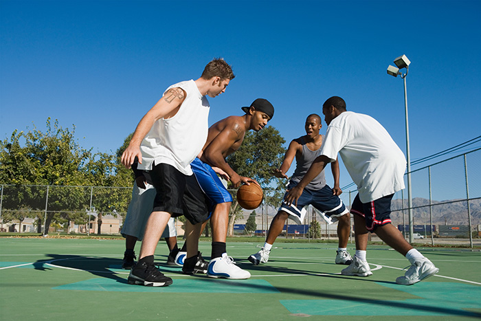 Friends playing basketball with composite type basketball
