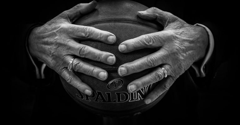 Hands holding basketball