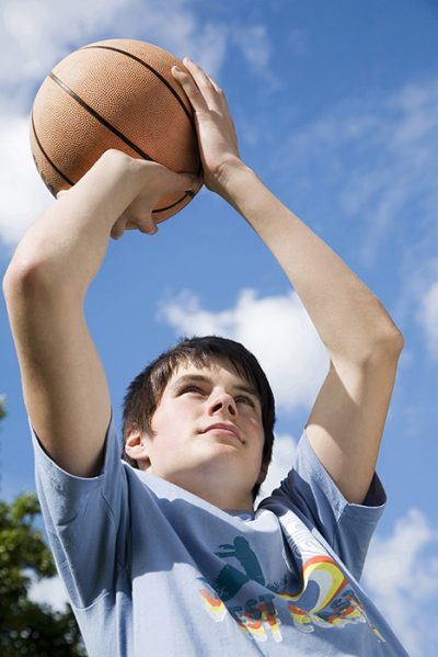 boy shooting basketball (700x467)